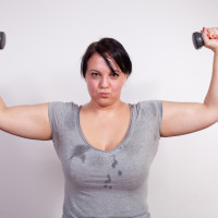 Woman_sweaty_with dumb bells